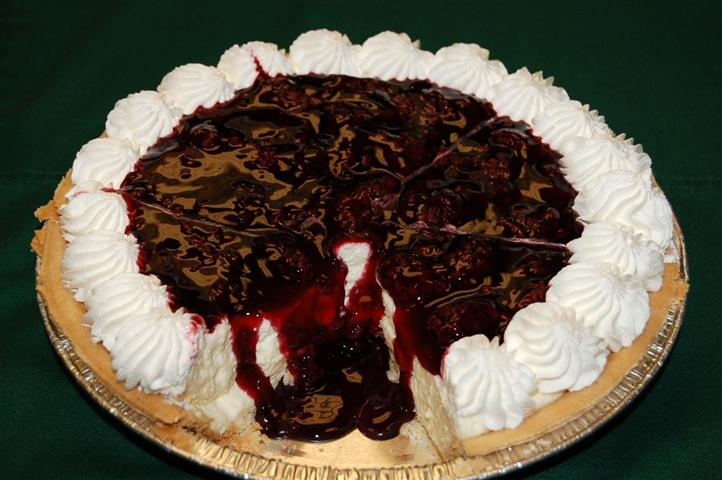 Pie with cherry and chocolate sauce.