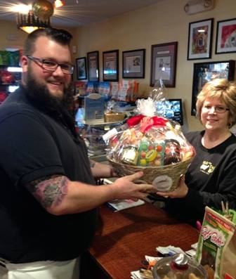 employee handing gift basket to customer
