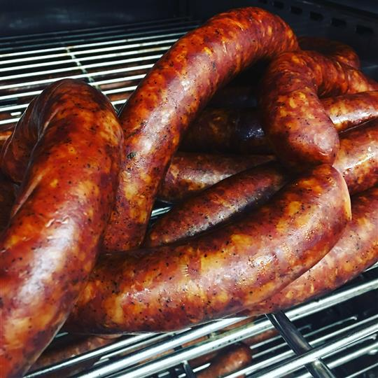 cooked sausage links on a grill