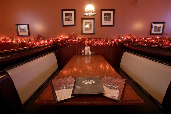 interior dining booth with decorative lighting on the walls