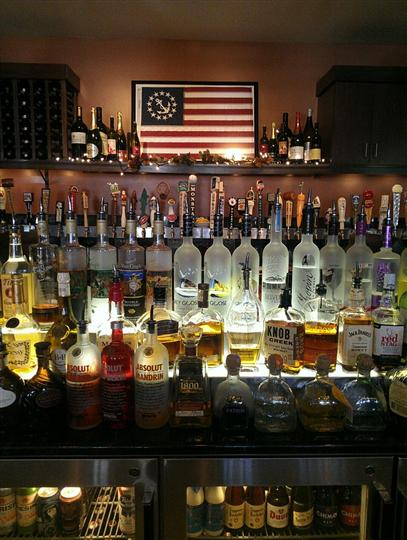 various liquor bottles displayed behind the bar area