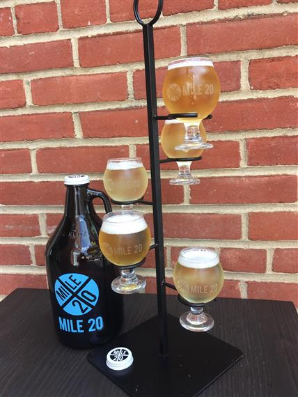Mile 20 beer jug and full beer glasses on vertical rack