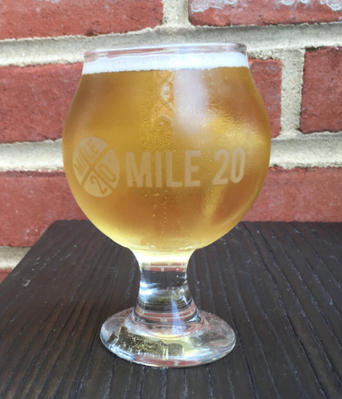 Full beer glass with Mile 20 logo