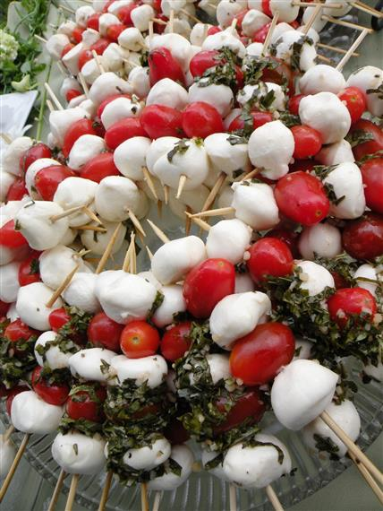 Mozzarella balls and cherry tomatoes on skewers