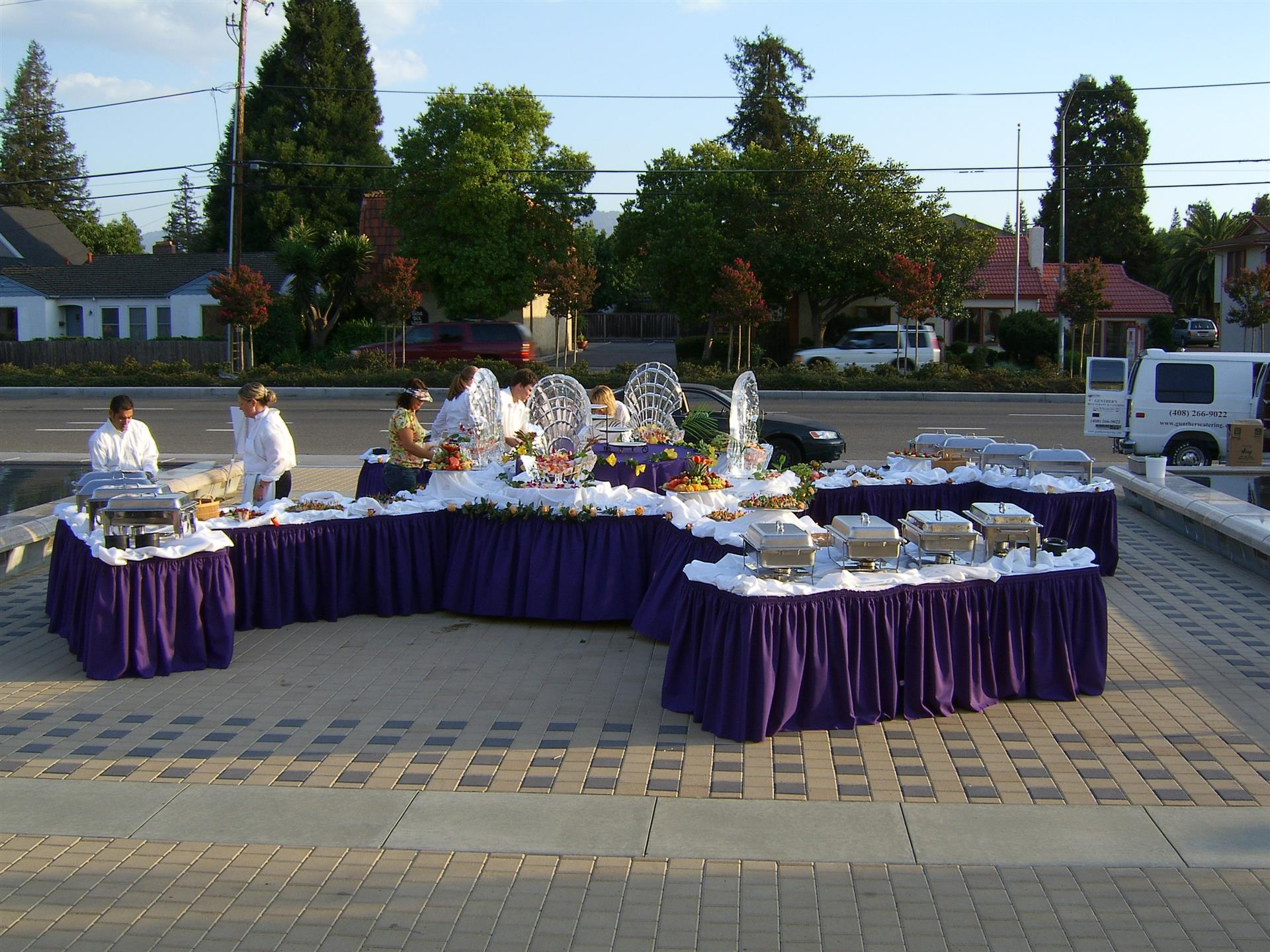 catering sternos on tables, catering staff outdoors at event