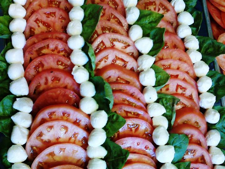 Caprese Salad - tomatoes, mozzarella, greens