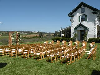 Rows of chairs on grass before wedding reception.