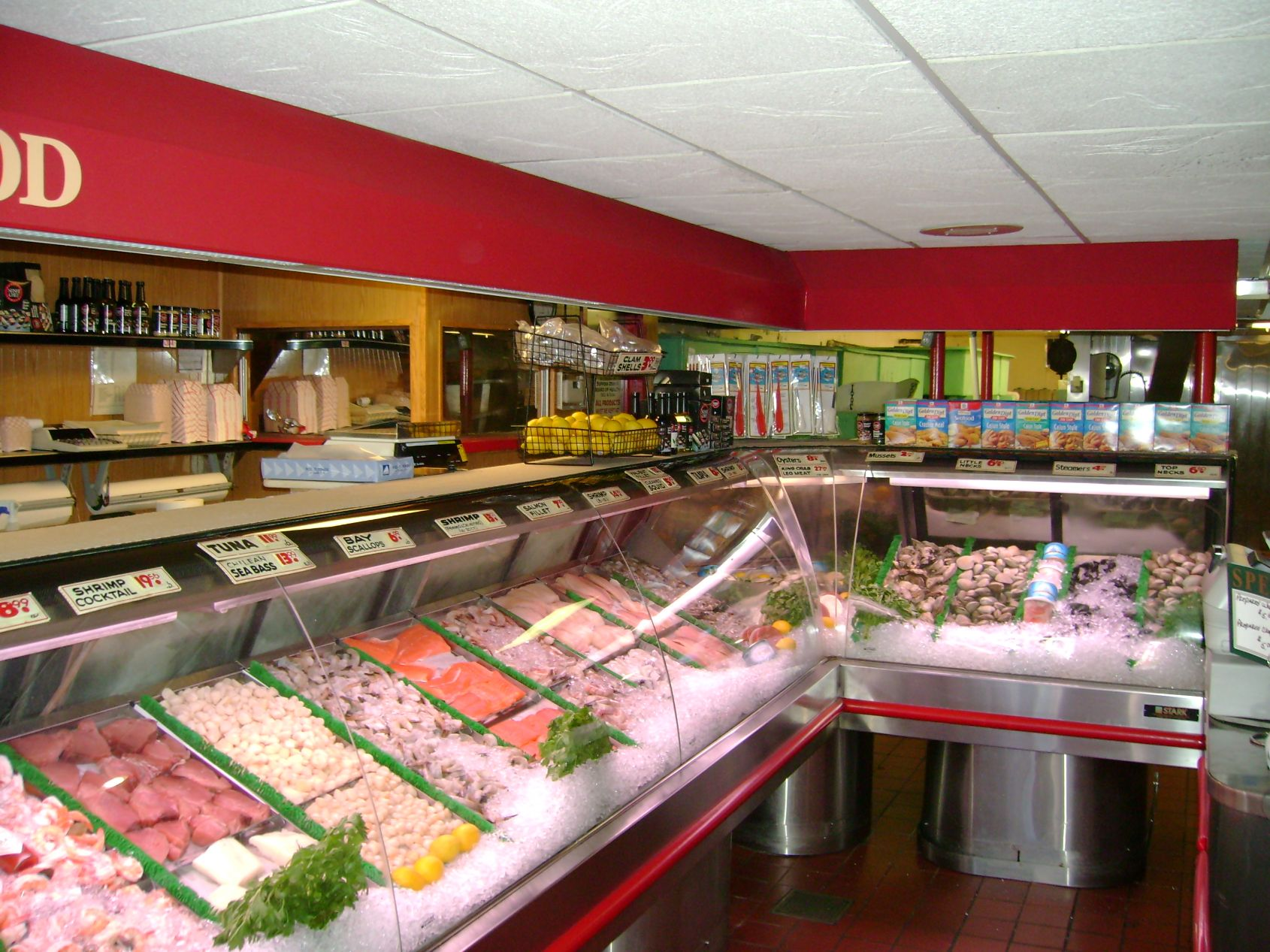 interior of the fish market with cases lined with fresh fish