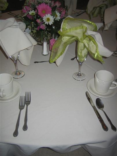 champagne glasses with decorative napkin inside