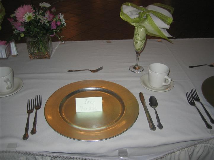 Table setting with utensils and note card placed on the plate