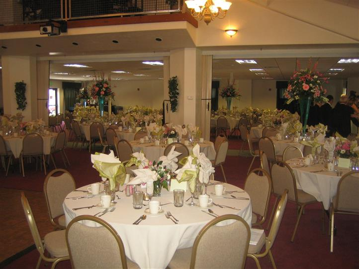 banquet Hall set up with tables, chairs, and centerpieces