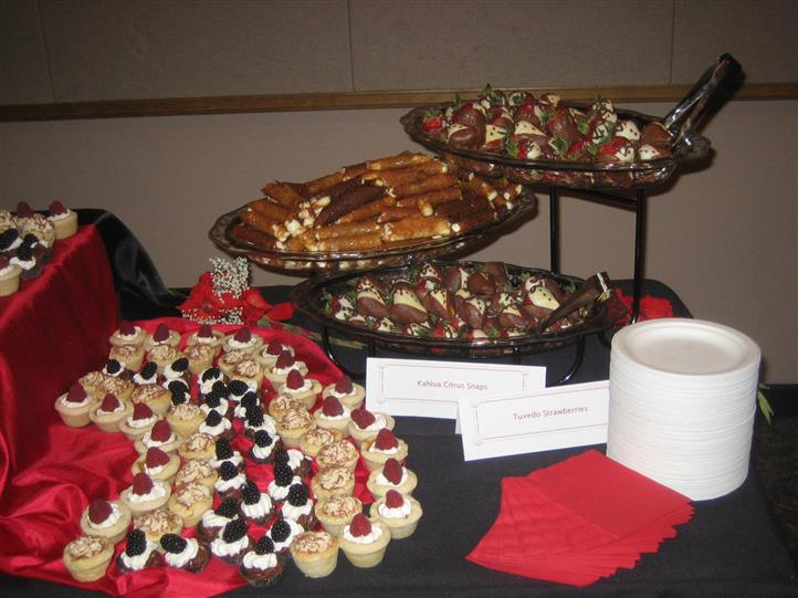 Assortment of small desserts and appetizers lined up on table