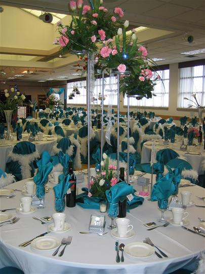 banquet hall setup with tables, chairs and centerpieces