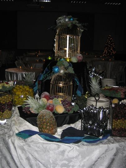 Assortment of fruit and silverware on table