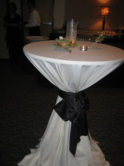 small round table with candle centerpiece