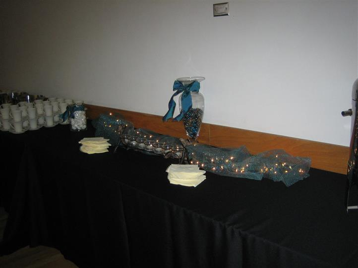 Long table decorated with lights and a vase