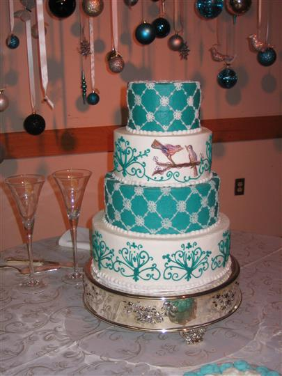 Four tier cake decorated with various designs