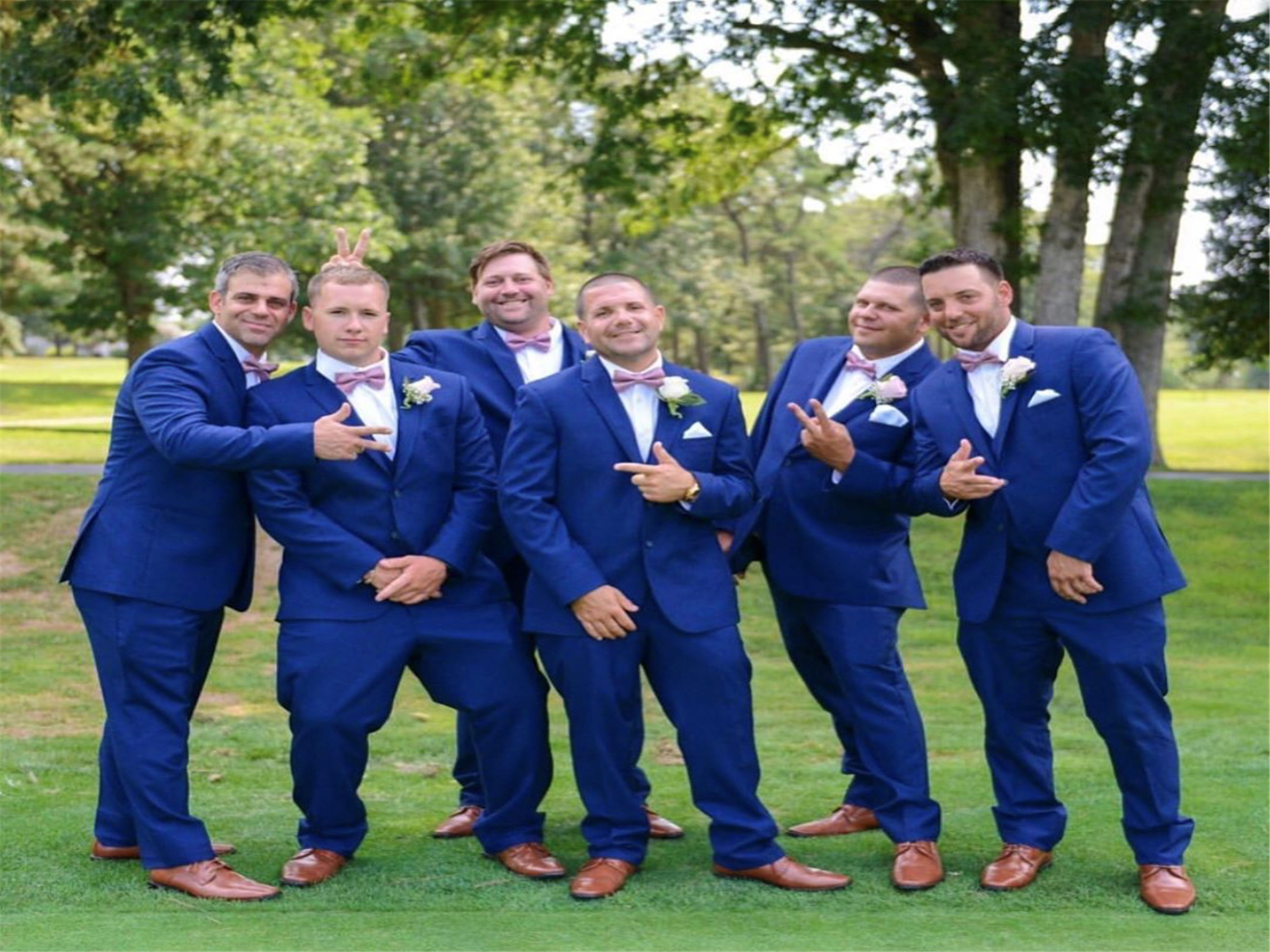 6 groomsman posing for a photo