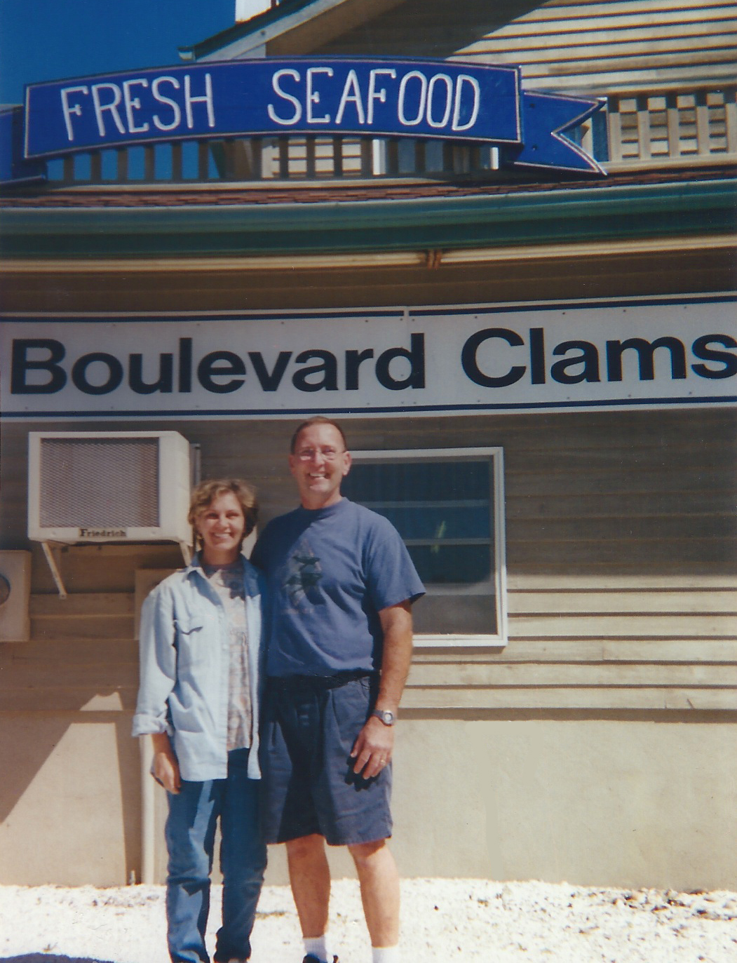 a couple standing in front of boulevard clams