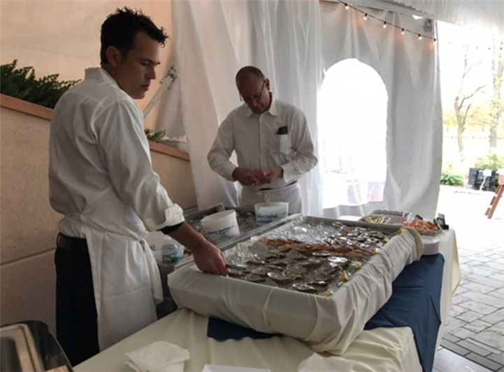 two employees preparing buffet table