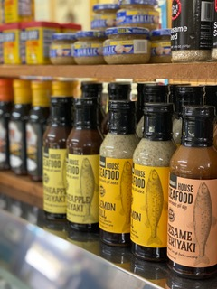 several lined-up bottles of seafood seasoning