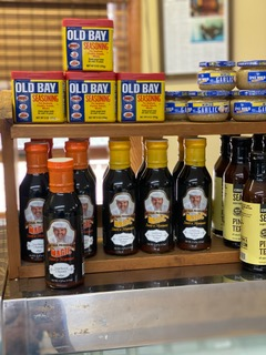 Old Bay seasoning, garlic, and various other bottles of seafood seasoning