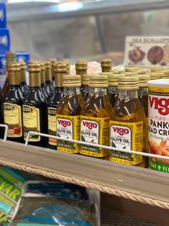 olive oil, panko, and various other bottles of seafood seasoning