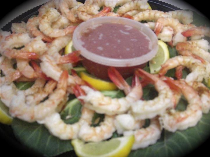 shrimp with dipping sauce on a tray