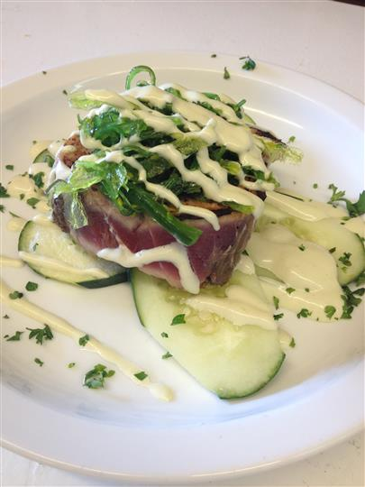 raw fish over cucumbers