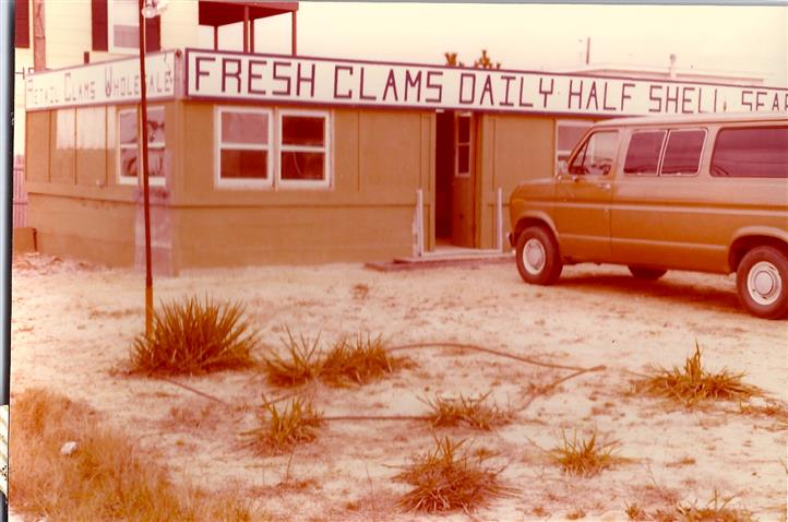 vintage photo with sign that reads fresh clams daily half