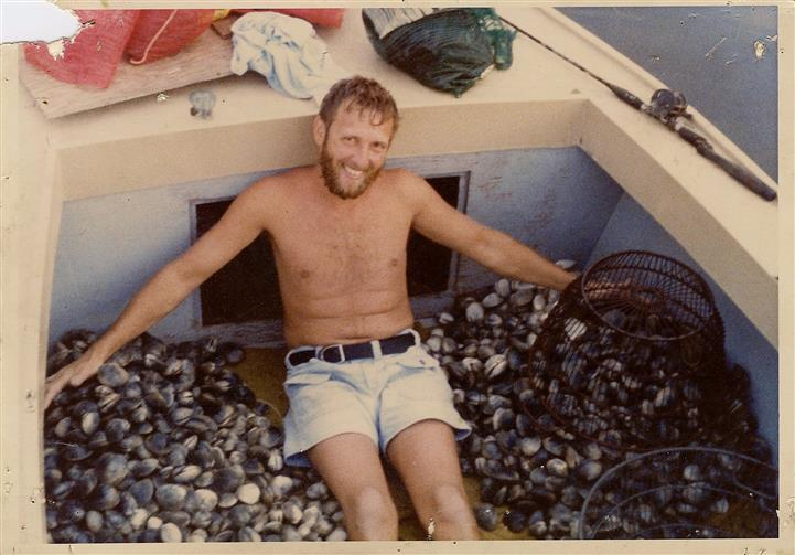 man on boat full of oysters