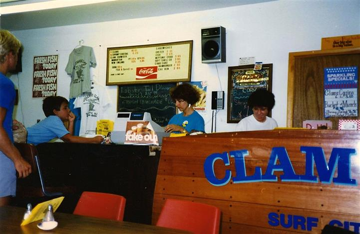 two females working behind counter