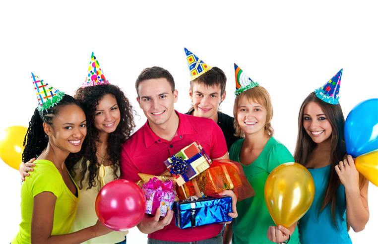 people wearing birthday hats and holding balloons