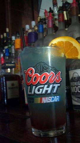 A glass of Coors Light at the bar