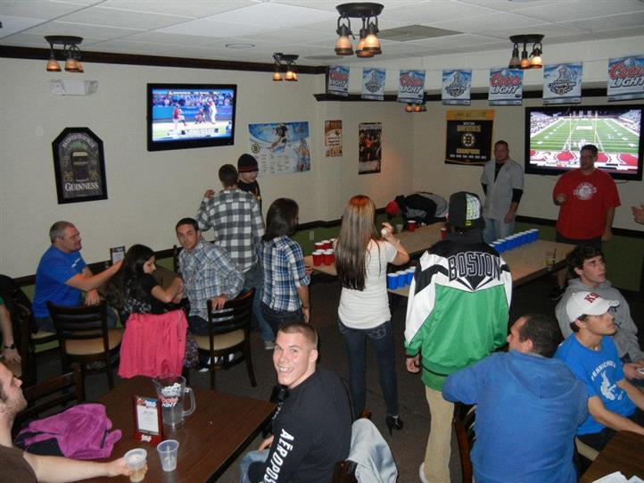 People watching sports on TV in the bar