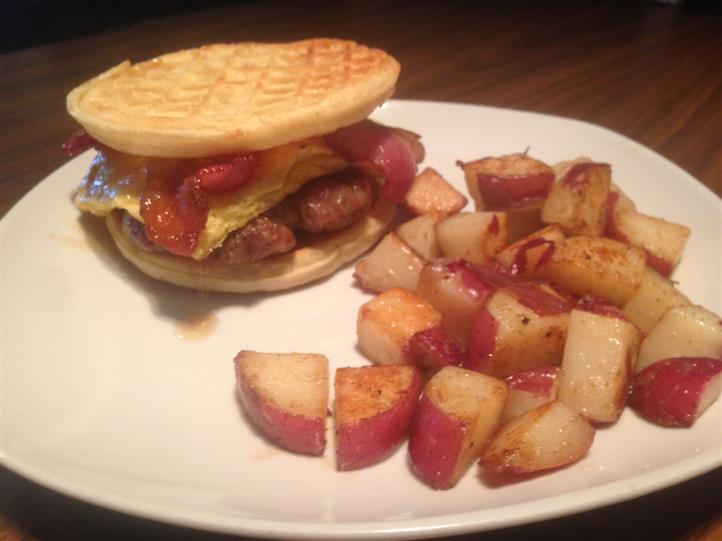 A beef burger served in a crumbet, served with red skinned potatoes