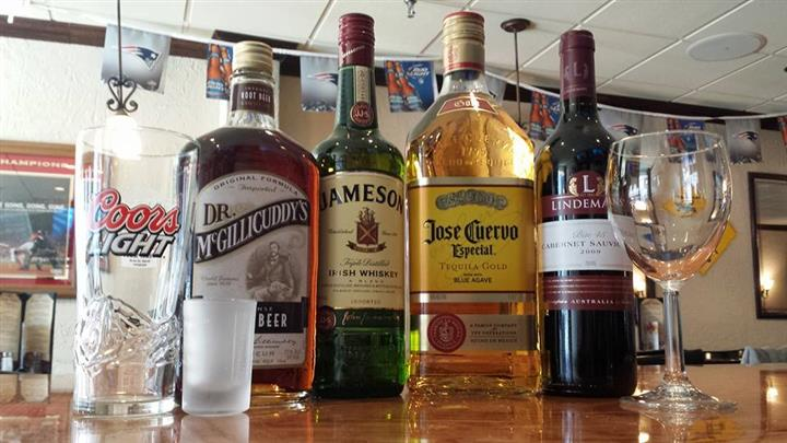 Four bottles of whiskies, tequilas and other drinks
