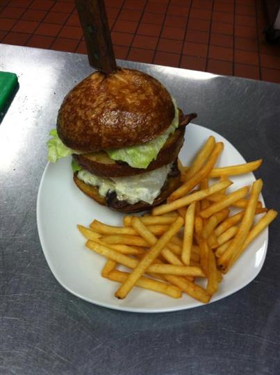 A double burger served with French fries