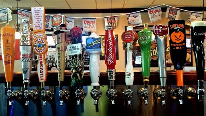 Row of variety of beer taps