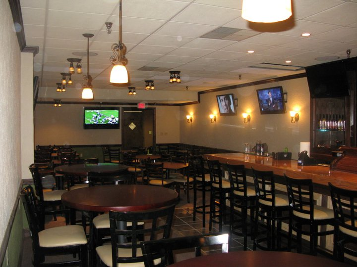 Interior shot of the bar showing tables and chairs