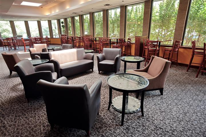 Seating area with big sofas and armchairs right by the tables