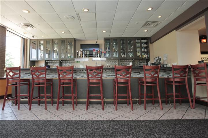 Bar set with stools and big cabiinets on the wall