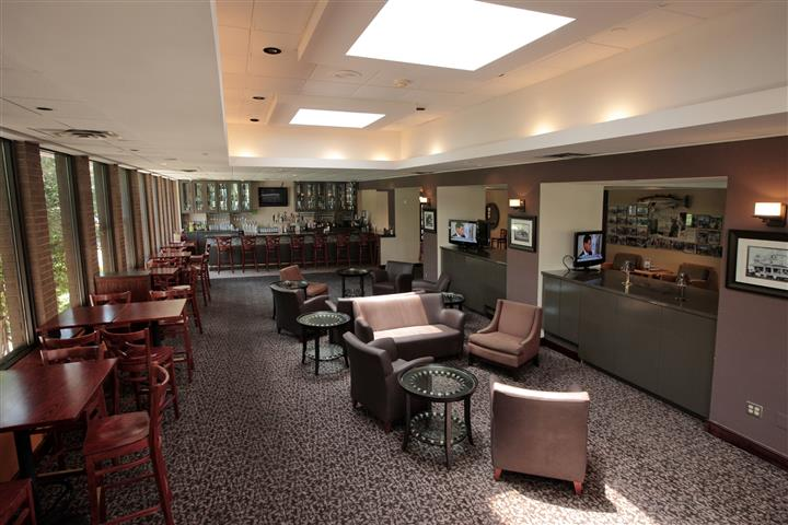 Reception lounge area with seating and tv screens