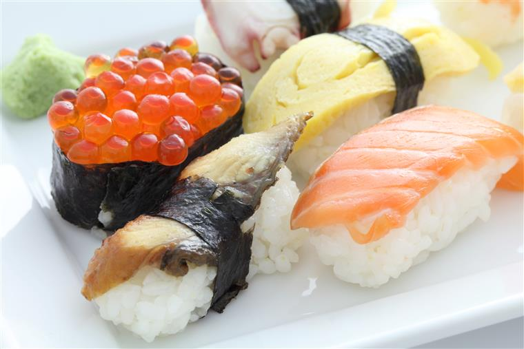 assorted sushi in a white plate