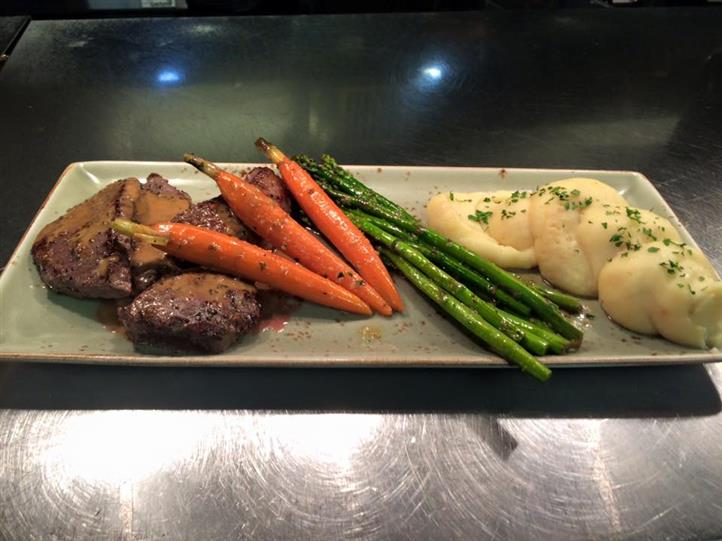 Steak with carrots, asparagus, and whipped potatoes