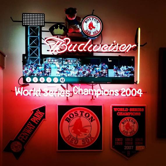 Neon budweiser sign showing fenway park. Boston red sox. World series champions 2004.