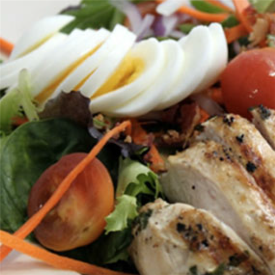 Grilled chicken salad with sliced boiled eggs