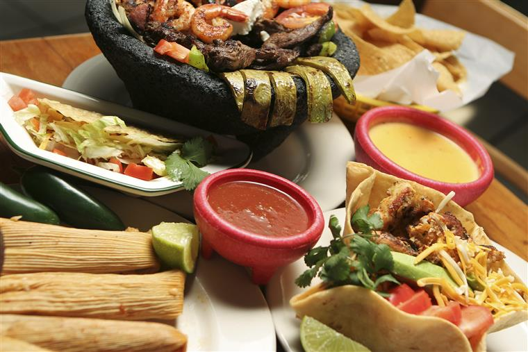 a MIXED PLATTER WITH TACOS, TAMALES AND FAJITA VEGETABLES