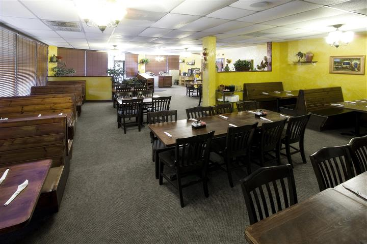 Interior of the restaurant with tables and chairs set
