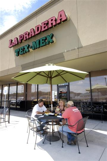 Outside of La Pradera with a table of four customers eating outside